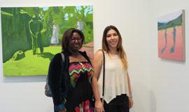 Two woman smiling in Trustman Gallery
